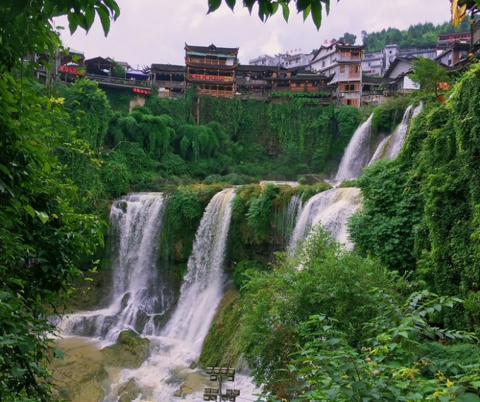 Hi,China Furong Ancient Town which was built on the top of waterfall banner