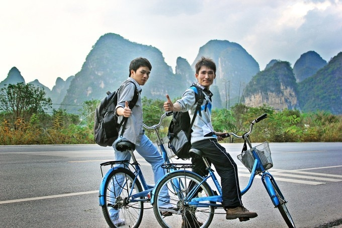 Riding in the natural gallery of Yangshuo and the wild villages